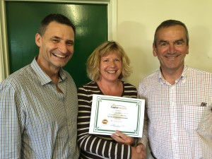 Sue Stockdale, along with Ian Williams, Executive Director and John White, Chair of the Board at Caplor Horizons